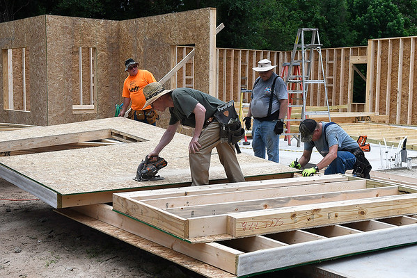 Volunteers for World Mission Builders workl at a house they are building on west Randolph Monday, June 3, 2019. (Billy Hefton / Enid News & Eagle)