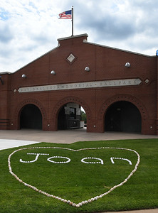 Baseballs spell the name Joan on th elawn of David Allen Memorial Ballpark Saturday June 15, 2019, in honor of Joan Allen. (Billy Hefton / Enid News & Eagle)