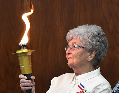 Harriet Morland watches the flame during a Flame ceremony as part of the Carry the Flame Across America Saturday, June 15, 2019. Carry the Flame Across America is an annual Ride from California to Washington D.C. by motorcyclists' traveling to the Vietnam Veterans Monument. The group stopped in Enid at Oklahoma's official Vietnam War Monument to host a Flame Ceremony in honor of the fallen of Vietnam. (Billy Hefton / Enid News & Eagle)