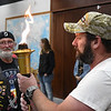 Chris Gilbert holds a flame during a ceremony as part of the Carry the Flame Across America Saturday, June 15, 2019. Carry the Flame Across America is an annual Ride from California to Washington D.C. by motorcyclists' traveling to the Vietnam Veterans Monument. The group stopped in Enid at Oklahoma's official Vietnam War Monument to host a Flame Ceremony in honor of the fallen of Vietnam. (Billy Hefton / Enid News & Eagle)