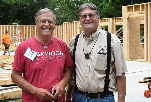 Brothers, Paul and Joe Wilson, at a house being built by World Mission Builders on west Randolph Monday, June 3, 2019. (Billy Hefton / Enid News & Eagle)