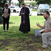 Rodney Fowler, head of transitional housing ministry for Hope Outreach Ministries, kneels as he says a prayer during A National Day of Mourning and Lament Monday, June 1, 2020. Faith leaders came together to pray for the 100,000 people from the United States who have died from COVID-19. (Billy Hefton / Enid News & Eagle)
