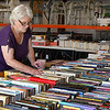 Charlene Wilson sorts book preparing for the Hospice Circle of Love book sale. The sale will be June 5th 9 am - 7 pm and June 6th 9 am - 5 pm. (Billy Hefton / EndiNews & Eagle)