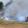 A grass rig fights a fire on the northeast corner of 42nd and Chestnut Tuesday, June 16, 2020. (Billy Hefton / Enid News & Eagle)