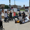Protesters kneel in front of the Garfield County Courthouse Tuesday, June 2, 2020. (Billy Hefton / Enid News & Eagle)