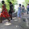 Members of the of Enid High School senior Class of 2020 across the bridge at Government Spring Park during the 105th May Fete Sunday, June 14, 2020. (Billy Hefton / Enid News & Eagle)