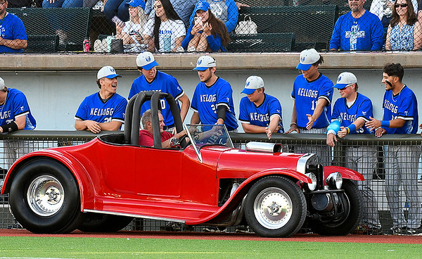 Players from Kellogg CC greet cars in the parade of classic cars prior to their game Wednesday, June 2, 2021 during the NJCAA DII World Series at David Allen Memorial Ballpark. (Billy Hefton / Enid News & Eagle)