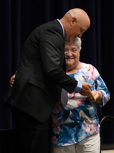 Janet Cordell gets a hug from Todd Hamilton as he presents her with the Citizen of the Year Award during the Greater Enid Chamber of Commerce annual meeting and banquet Tuesday, June 15, 2021 at the Stride Bank Center. (Billy Hefton / Enid News & Eagle)