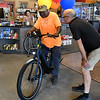 Micah Stone, from The Bike Shop, shows Abe Davenport some of the features of his new electric assist bike Wednesday, June 24, 2021. (Billy Hefton / Enid News & Eagle)