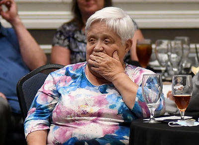 Janet Cordell covers her mouth as she listen to her bio for being the recipient of the Citizen of the Year Award during the Greater Enid Chamber of Commerce annual meeting and banquet Tuesday, June 15, 2021 at the Stride Bank Center. (Billy Hefton / Enid News & Eagle)