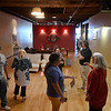 Cecilia Holle talks with guest during a tour of a finished living space at 117 N. Grand during an Upper Floor Housing Tour Wednesday, June 17, 2021. (Billy Hefton / Enid News & Eagle)