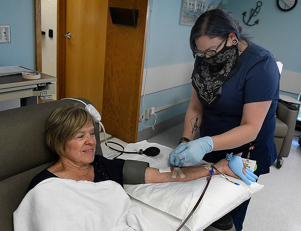 Sky Monge, a Donor Room Supervisor at Oklahoma Blood Institute, helps Kay Blakey as she donates Tuesday, June 22, 2021. (Billy Hefton / Enid News & Eagle)