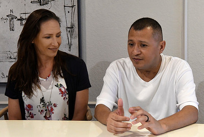 Jeremy Lopez talks about recovering from Covid-19 as his wife, Crystal, looks on during an interview Friday, June 11, 2021. (Billy Hefton / Enid News & Eagle)