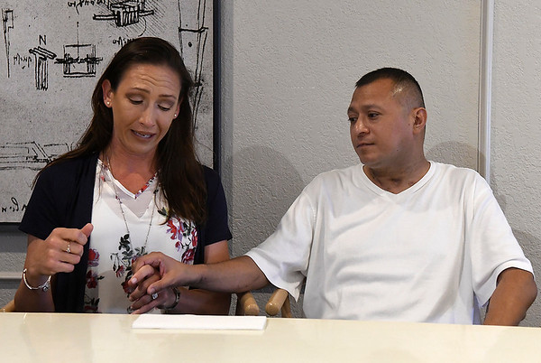 Jeremy Lopez holds the hand of his wife, Crystal, as she talks her hushand's struggle with Covid-19 during an interview Friday, June 11, 2021. (Billy Hefton / Enid News & Eagle)