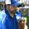 Bob Archer holds Huey at Old Paws Rescue Ranch Thursday, June 10, 2021. (Billy Hefton / Endi News & Eagle)