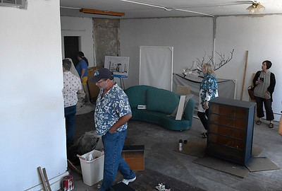 Guest look over an unfinished living space at 222 West Randolph during an Upper Floor Housing Tour Wednesday, June 16, 2021. (Billy Hefton / Enid News & Eagle)