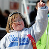 Glenwood's Taylor Berg celebrates her second-place finish on the award stand during the Special Olympics Outdoor Track and Field competition at Vance Air Force Base Thursday, March 28, 2013. (Staff Photo by BONNIE VCULEK)
