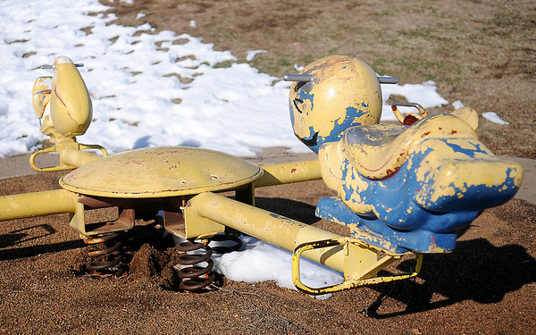 A teeter totter for toddlers at Meadowlake Park South needs a fresh coat of paint. (Staff Photo by BONNIE VCULEK)