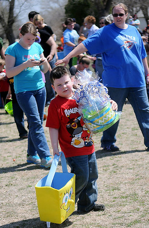 Kross Brown, 5, was one of the big winners during Sandbox Learning Center's annual Easter egg hunt Saturday, March 30, 2013. The center's employees and Northwestern Oklahoma State University Psychology Club filled thousands of eggs with candy and prizes before children arrived. (Staff Photo by BONNIE VCULEK)