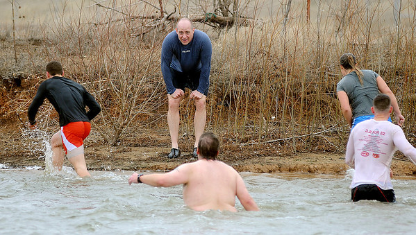 Col. Darren James, Commander of Vance Air Force Base's 71st Flying Training Wing, takes the Crosslin Park Island first as five swimmers braved the frigid water aduring the Warren Edds Memorial Civitan Chiller Challenge Saturday, March 9, 2013. (Staff Photo by BONNIE VCULEK)