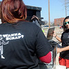 Itsel Martinez (left) and Zahira Rojo sport Enid Iron and Metal t-shirts as they help with the Enid High School Community Service Club's Community Recycling Saturday, March 30, 2013. Employees from Enid Iron and Metal did most of the heavy lifting as donations were brought to the southeast parking area at Enid High. Proceeds from the sale of the scrap metal products will fund educational activities for the Pacers and Plainsmen students. (Staff Photo by BONNIE VCULEK)