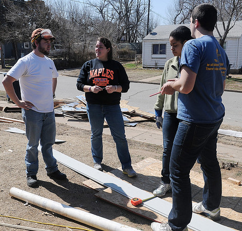 Patrick Barnhouse, Nicole Grieve, Lindsay Jackson and Brian Jacobs are among the Marquette students that gave up their spring break to work on a Habitat for Humanity home in Enid March 11-16, 2013. (Staff Photo by BONNIE VCULEK)