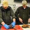 Enid Noon Ambucs' Drew Ewbank and Dalen McVay (from left) prepare pulled pork for the Kansas City Barbeque Society BBQ judging class at Northern Oklahoma College-Enid Saturday, March 9, 2013. (Staff Photo by BONNIE VCULEK)