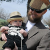 Gabe Watts holds his son, Corbin, as the pair compete during Moustache March events at Government Springs Park Saturday, March 16, 2013. Little Corbin was styling with his own black felt moustache, vest and hat. (Staff Photo by BONNIE VCULEK)