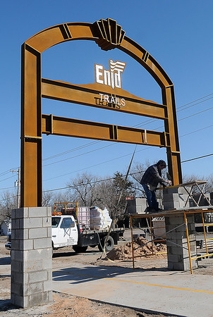 A masonry worker lays concrete blocks around the base of one of the Enid Trails' entrances near D. Bruce Selby Stadium Tuesday, March 5, 2013. (Staff Photo by BONNIE VCULEK)