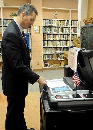 A voter scans his ballot during the Garfield County special election on the Enid Quality of Life Initiative Tuesday, March 5, 2013. (Staff Photo by BONNIE VCULEK)
