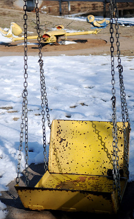 A handicap swing and a spring activated teeter totter for young children at Meadowlake Park South show severe rust and need to be repaired or replaced. (Staff Photo by BONNIE VCULEK)