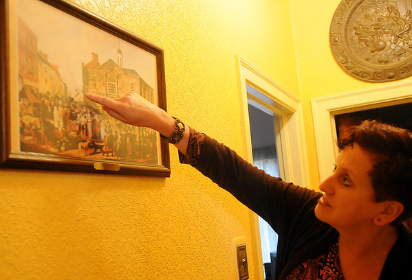Ursula Tuohy locates her bedroom window in a print of Ennis Co. Clare, Ireland 1790 Tuesday, March 12, 2013. Tuohy, who grew up in Ireland, returns to her native homeland every two years. Tuohy and her husband, Kevin, live in Enid. (Staff Photo by BONNIE VCULEK)