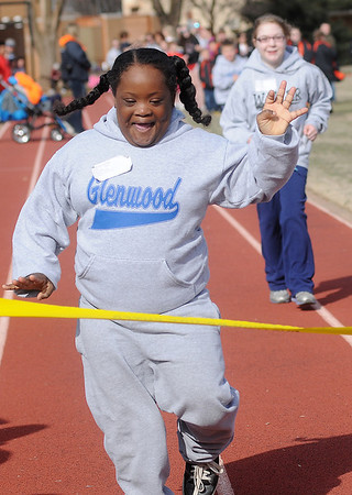 Destinee Sullivan sprints to the finish line during the Division 2, 50-yard dash during Special Olympics competition at Vance Air Force Base Thursday, March 28, 2013. Nearly 200 athletes participated in the events. (Staff Photo by BONNIE VCULEK)