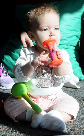 "Berlyn Curttright plays with early childhood development toys during a weekly ""open play"" time with her mother, Sara, at the CDSA Non-Profit Center Wednesday, March 20, 2013. (Staff Photo by BONNIE VCULEK)"