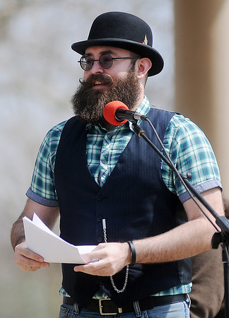 Travis Nance, from the Oklahoma City Beard Club, introduces the Moustache March ambassadors at Government Springs Park Saturday, March 16, 2013. (Staff Photo by BONNIE VCULEK)