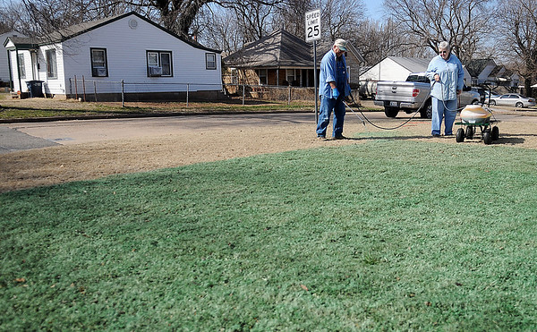 Don and Betty Herth work together as they spray their lawn with pre-emergent, Round Up and broadleaf chemicals at 1922 E. Maple Wednesday, March 13, 2013. For years they had a professional lawn care service until they decided to save money and do the job themselves. (Staff Photo by BONNIE VCULEK)