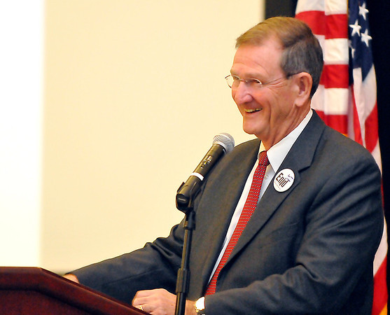 Enid mayor, Bill Shewey, shares a laugh with the audience during his State of the City address Monday at Convention Hall. (Staff Photo by BILLY HEFTON)