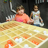 Derby Darling and Emma Webber (from left) explore their building options in the new Tinkering exhibit at Leonardo's Discovery Warehouse Friday, March 15, 2013. The Oklahoma Museum Network permanent exhibit was funded by Donald W. Reynolds Foundation.(Staff Photo by BONNIE VCULEK)