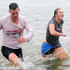 Adam Smith and Sherry Ginger exit the frigid Crosslin Park Lake water during the Warren Edds Memorial Civitan Chiller Challenge. Proceeds from the event support special olympics in Enid. (Staff Photo by BONNIE VCULEK)