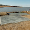 Work on the boat ramp at the Canadian Recreation Area day use facility on Canton Lake. (Staff Photo by BILLY HEFTON)