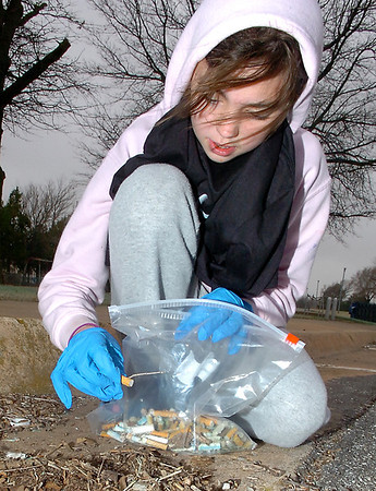 Heather Keith picks up a cigarette butt Sunday at Meadowlake Park during Kick Butts Day, an annual event that informs youths about the dangers of tobacco, sponsored by the Garfield County Tobacco Free Coalition, United Way of Enid and Northwest Oklahoma and S.W.A.T (Students Working Against Tobacco). (Staff Photo by BILLY HEFTON)