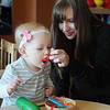"Sara Curttright and her 18-month-old daugther, McKartney, play together during a weekly ""open play"" time at the early childhood development program in the CDSA Non-Profit Center Wednesday, March 20, 2013. (Staff Photo by BONNIE VCULEK)"