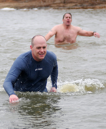 Col. Darren James (left), Commander of Vance Air Force Base's 71st Flying Training Wing, and MSgt. John Ward, retired, brave the icy water at Crosslin Park Lake during the Warren Edds Memorial Civitan Chiller Challenge Saturday, March 9, 2013. Five individuals took the plunge as swimmers and runners raised money for special olympics in Enid. (Staff Photo by BONNIE VCULEK)