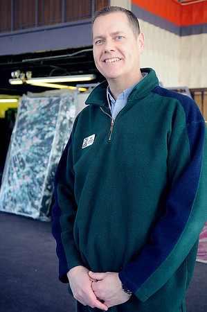 Matt Lohman pauses in the furniture and mattress storage area at Hope Outreach. In addition to the thrift store, Hope Outreach provides services through their community care, homeless , and parenting ministries and operates the Faith Farm Enabling Garden. (Staff Photo by BONNIE VCULEK)