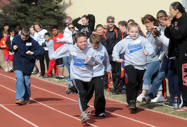 Special Olympians run the 50-yard dash during the Special Olympics Outdoor Track and Field events at Vance Air Force Base Thursday, March 28, 2013. (Staff Photo by BONNIE VCULEK)