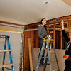 Marquette students hang sheetrock inside a Habitat for Humanity home at 2001 E. Maple Wednesday, March 13, 2013. Thomas Gill (right) and seventeen other Marquette students gave up their spring break to help build the new home for an Enid family. (Staff Photo by BONNIE VCULEK)