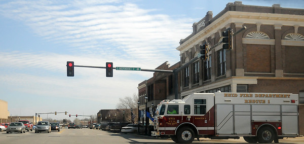 Enid Fire Department Rescue 1 crew responds to an emergency call in downtown Enid Wednesday, March 13, 2013. (Staff Photo by BONNIE VCULEK)