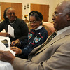 Loretta Ore, Lubertha Johnson and Rev. Alfred Baldwin II (from left) discuss the mission statement for First Missionary Baptist Church Wednesday, March 6, 2013. Ore and Johnson meet each week to organize the local church's mission activities. (Staff Photo by BONNIE VCULEK)