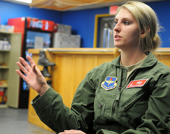 2nd Lt. Kayla Bowers describes the differences between flying the T-6 and T-38 during an interview at the Vance Air Force Base 25th Flying Training Squadron building Wednesday, March 27, 2013. Bowers is part of Class 13-13. (Staff Photo by BONNIE VCULEK)
