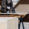 Ed Winters, from Henson Construction, cuts a piece of plywood decking for the roof of the new Kiwanis Carousel building at Meadowlake Park North Thursday, March 21, 2013. (Staff Photo by BONNIE VCULEK)